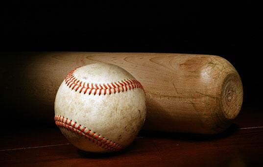 Baseball and Bat on a dark background
