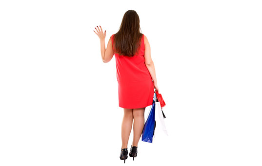 shopping woman gives a wave goodbye