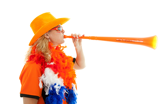 Dutch soccer supprter with plastic vuvuzela